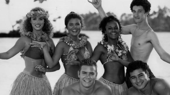 "NBC photo from the ""Saved By The Bell"" ""Hawaiian Style"" episode: Front row: (from left) Mark-Paul Gosselaar, Mario Lopez.  Back row: (from left) Elizabeth Berkley, Tiffani Thiessen, Lark Vorhees and Dustin Diamond."