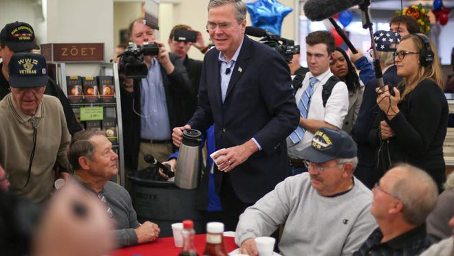 Former Florida Gov. Jeb Bush, who is currently running as a GOP candidate for President of the United States, spent time serving coffee and chatting with veterans at Hy-Vee grocery store on Wednesday, Nov. 11, 2015, in Johnston, Iowa.