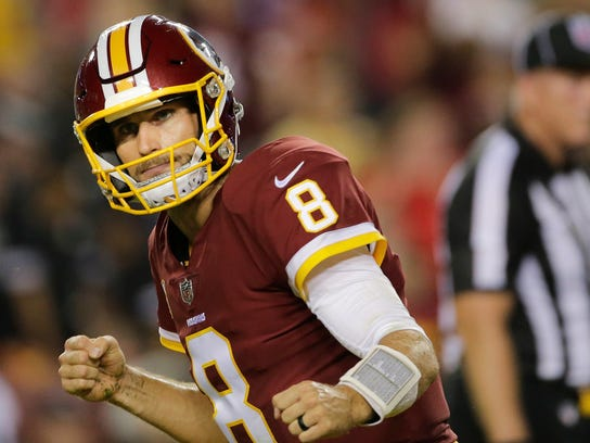 Washington Redskins quarterback Kirk Cousins (8) celebrates his touchdown pass to tight end Vernon Davis (85) during the first half of an NFL football game against the Oakland Raiders in Landover, Md., Sunday, Sept. 24, 2017. (AP Photo/Mark Tenally)