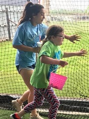 Airline's Kourtnee White helps Emilie Gibson with the Easter egg hunt.
