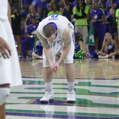 FGCU senior Brett Comer reacts as the Eagles lose to