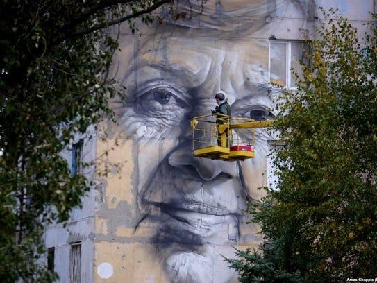 A mural painted by Guido van Helten in Ukraine.