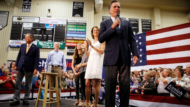 """""""I came out here to make it clear that the whole country is watching what Ohio does,"""" said Mitt Romney, right, campaigning for Ohio Gov. John Kasich, left, Monday in Westerville. (AP Photo/Matt Rourke)"""