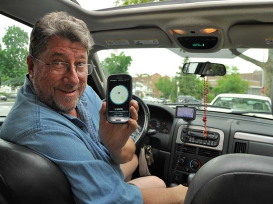 Billy Neumann of Rutherford works as an Uber driver in 2016.