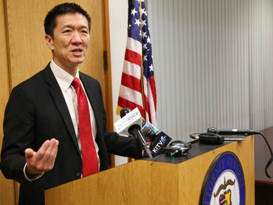 Hawaii Attorney General Douglas Chin speaks at a news