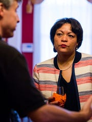 New Orleans mayoral candidate LaToya Cantrell listens