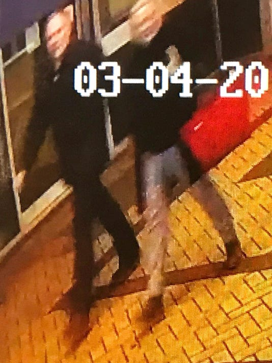 "In this image taken from security camera footage from PA  shows a man and woman as they walk through an alleyway connecting a Zizzi's restaurant to a bench where  former Russian double agent Sergei Skripal was found in Salisbury on Sunday March 4, 2018  The image is believed to be of interest to police. British counter-terror specialists offered expertise Tuesday to police in southern England  as they sought to unravel the mystery of why a former Russian spy fell critically ill following exposure to an ""unknown substance."" Authorities maintained a cordon near the spot where former double agent Sergei Skripal and an unidentified woman collapsed Sunday in Salisbury. (AP Photo)"