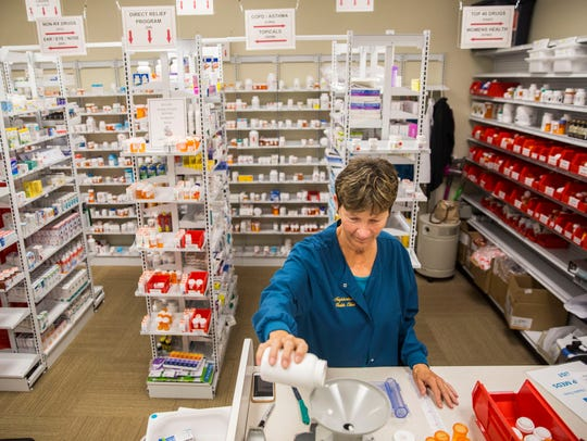 Nancy Windatt fills prescriptions in the pharmacy at