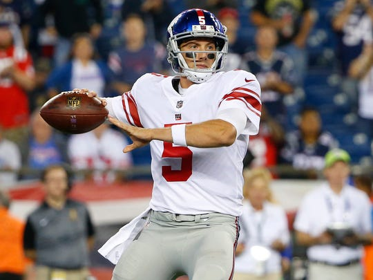 FILE - In this Aug. 31, 2017, file photo, New York Giants quarterback Davis Webb looks to pass during the second half of an NFL preseason football game against the New England Patriots,in Foxborough, Mass. Giants players get back to work after their 51-17 loss to the Rams and some are suggesting it's time to let rookie quarterback Davis Webb play for Eli Manning with the team at 1-7. (AP Photo/Winslow Townson, File)