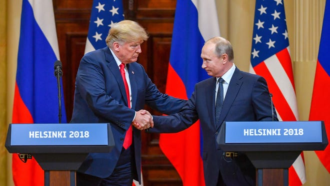 U.S. President Donald Trump and Russian President Vladimir Putin shake hands at Helsinki Summit on Monday, July 16, 2018.