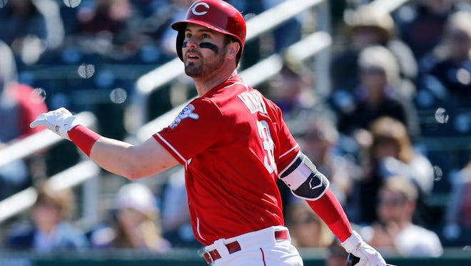 Cincinnati Reds outfielder Jesse Winker (33) hits a ground rule double on a line drive to left field in the bottom of the first inning of the Spring Training game between the Cincinnati Reds and the Colorado Rockies at Goodyear Ballpark in Goodyear, AZ, on Saturday, Feb. 24, 2018.