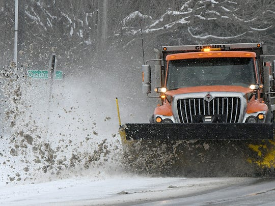 An Ontario snow plow driver clears snow on 4th Street near Overbrook Court in March 2017.
