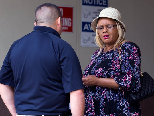 Lena Holmes, the mother of Elton Wayne Holmes, who is accused in the fatal hit-and-run crash that killed a King High School student, talks with a courthouse official following a hearing for her son on Tuesday, April 3, 2018.