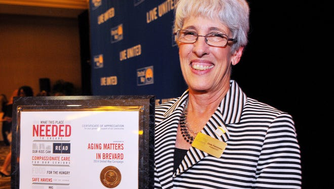 Cindy Flachmeier of Titusville, President/CEO of Aging Matters of Brevard,  shows off their award during Thursday nights United Way 2015 annual Awards Celebration held at the Hilton Melbourne Rialto Place.