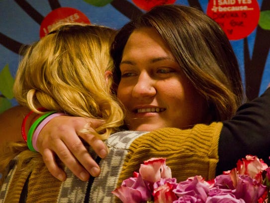 Danika Newberry hugs supporters after speaking at an