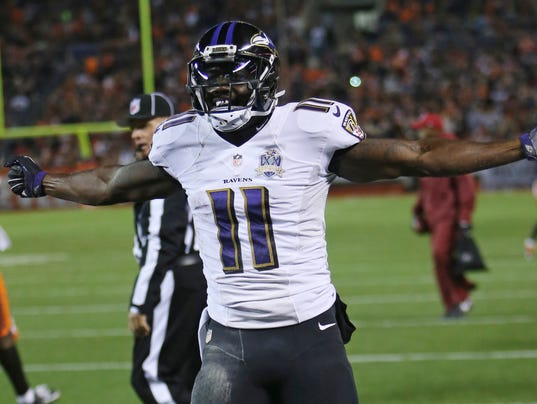 Baltimore Ravens wide receiver Kamar Aiken celebrates after scoring a