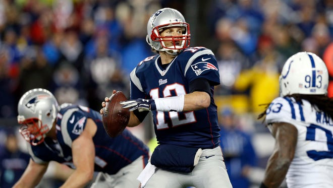 New England Patriots quarterback Tom Brady (12) throws a pass during the second quarter against the Indianapolis Colts in the AFC Championship Game at Gillette Stadium.