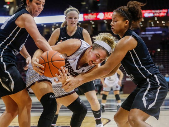 Audrey Holt fights to keep possession of the ball during