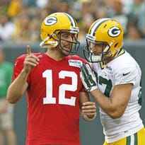 In this Aug. 8, 2015, file photo, Green Bay Packers Aaron Rodgers, left, and Jordy Nelson talk during the Green Bay Packers Family Fun Night NFL football training camp practice in Green Bay.