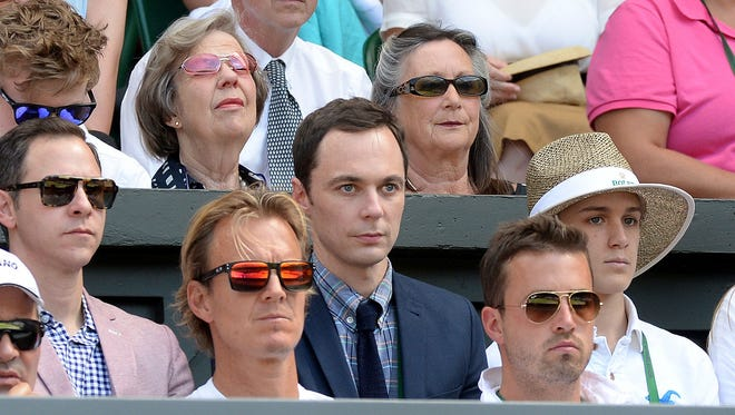 Actor Jim Parsons watches from  the players box during the Wimbledon women's semifinal match between Canada's Eugenie Bouchard and  Romania's Simona Halep at the All England Lawn Tennis Championships in Wimbledon, London, on July 3, 2014.