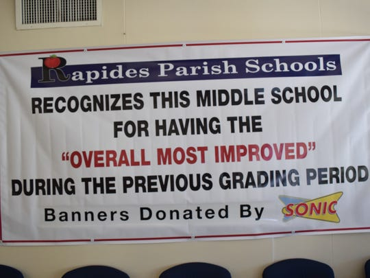 """The Rapides Parish School District is using data to reward schools for something other than their school performance scores from the state. This banner hangs at Alexandria Middle Magnet School, this nine weeks' winner of """"overall most improved"""" for middle schools in the district."""
