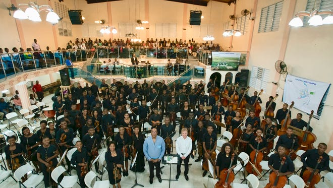 Utah Symphony music director Thierry Fischer (right) and Haitian conductor Pierre Leroy with participants in the National Orchestra Institute, March 30, 2018, Cap-Haitien, Haiti.