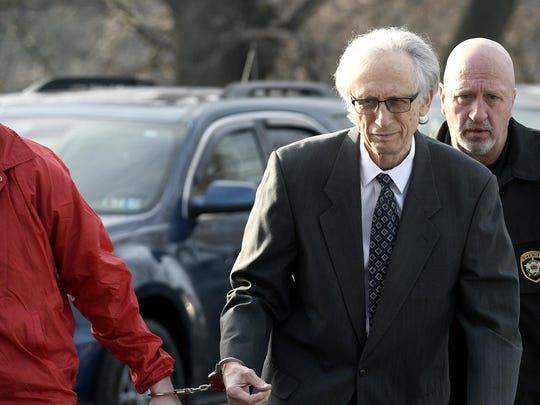 Dr. Johnnie Barto heads into Cambria County Courthouse,