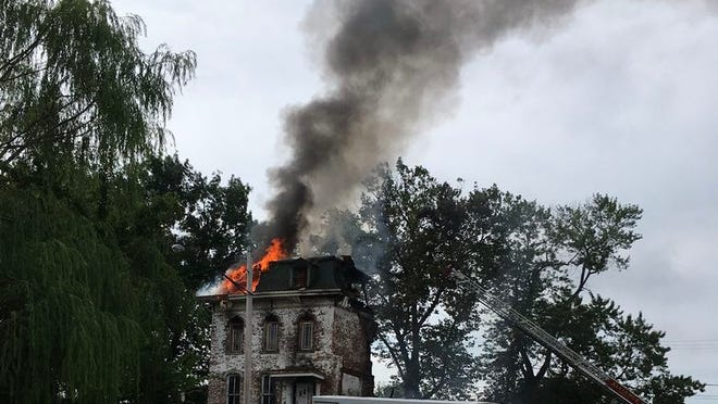 Alliance Fire officials suspect a fire that destroyed a 148-year-old house on East Columbia Street was deliberately set.