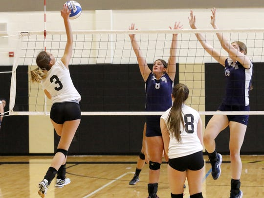 Kelsey Taylor of Corning goes up for a spike against