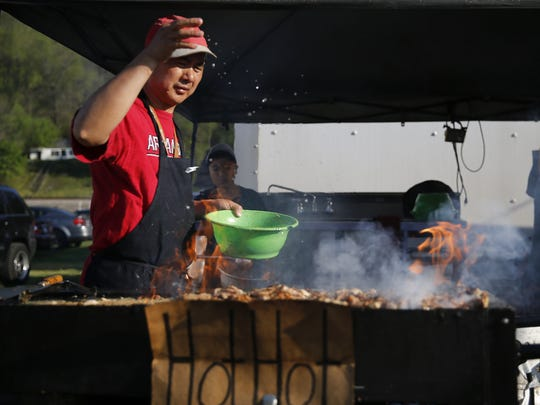Mike Wu, of China Rainbow restaurant, prepares chicken