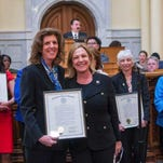 In the center, United Way ALICE Report author Stephanie Hoopes, left, is pictured here with Assemblywoman Valerie Huttle, after Hoopes was recognized for her work to shed light on the 1.2 million New Jersey families struggling daily to afford the basics.