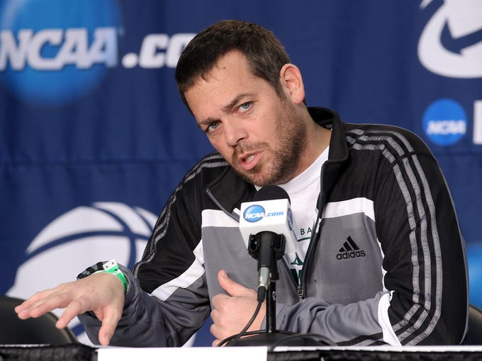 Manhattan head coach and former Rick Pitino assistant Steve Masiello answers a question during a press conference ahead of their NCAA matchup with U of L at the Amway Center in Orlando, Fl. Mar. 19, 2014