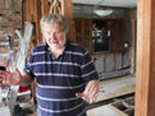 John Lambert in August 2013 showed reporters the damage to his home from Sandy. (file photo)