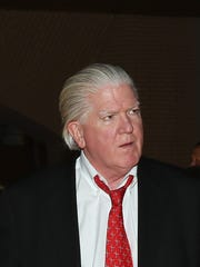 Brian Burke walks the red carpet before the Hockey Hall of Fame ceremony in Toronto on Monday.
