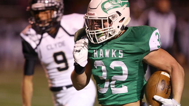 Wall's Tymber Carr runs the ball for a gain during the Hawks' game against the Clyde Bulldogs on Friday night.