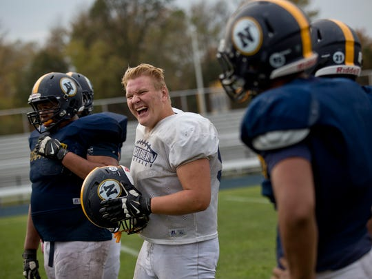Senior Mike Mahaffey laughs while joking around with others during practice Wednesday, October 21, 2015 at Port Huron Northern High School.