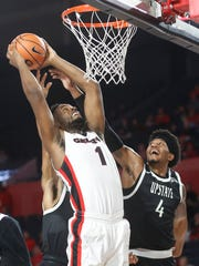 Georgia forward Yante Maten (1) takes a shot while being defended by South Carolina Upstate forward Ramel Thompkins (4) in the first half of an NCAA college basketball game in Athens, Ga., Tuesday, Nov. 14, 2017. (Joshua L. Jones/Athens Banner-Herald via AP)