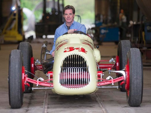 Pat Kennedy, the fourth generation head of Kennedy Tank & Manufacturing Co., with a vintage race car at the business, Indianapolis, Friday, May 9, 2014. The car, which ran in the 1948 and 1949 Indy 500 turns out around 350-400 horsepower, and can run the track at 130mph.