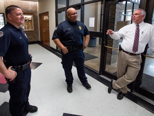 Prattville Police Department Sgt T.R. Hope, left, and Lt. Ray Wagner, center, chat with Prattville High School principal Brack Dunn at the school in Prattville, Ala. on Tuesday April 3, 2018.