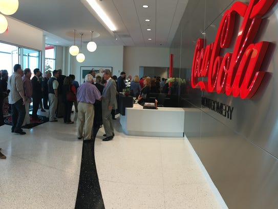 Visitors enter the new Coca-Cola United distribution