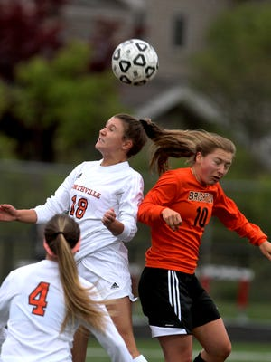 Brighton's Bailey Tuczak, right, battles a Northville player for the ball in last week's KLAA title game. Tuczak scored one of Brighton's goals in Tuesday's win over Novi.