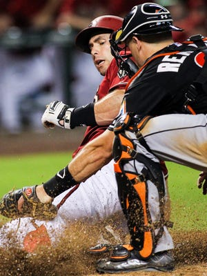 Arizona Diamondbacks baserunner Paul Goldschmidt (is tagged out at the plate by Miami Marlins catcher J.T. Realmuto in the eighth inning at Chase Field in Phoenix on Wednesday, July 22, 2015.