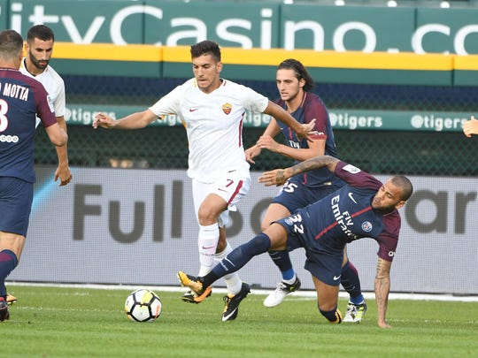 AS Roma's Lorenzo Pellegrini and Paris St. Germain's Dani Alves (32) battle for a loose ball during the first half. The teams played in the International Champions Cup at Comerica Park.