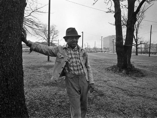 Charleston Thompson stands under the pecan trees near his former home in Little Texas in 1985. The trees served as the last reminder of that community until the Bi-Lo Center was built in 1996.