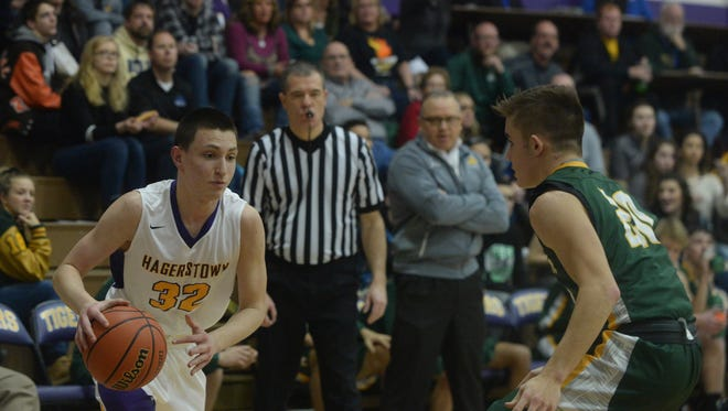 Hagerstown's Michael Howard (32) moves the ball to the basket agaisnt Alex Reynolds of Northeastern during the Wayne County tournament Thursday, Jan. 4, 2018 at Hagerstown High School.