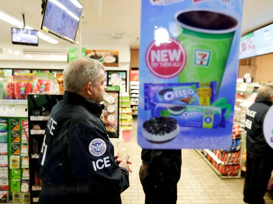 U.S. Immigration and Customs Enforcement agents serve an employment audit notice at a 7-Eleven convenience store Wednesday, Jan. 10, 2018, in Los Angeles. Agents said they targeted about 100 7-Eleven stores nationwide Wednesday to open employment audits and interview workers.