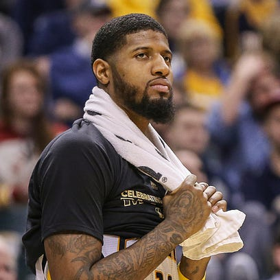 Indiana Pacers forward Paul George (13) watches second