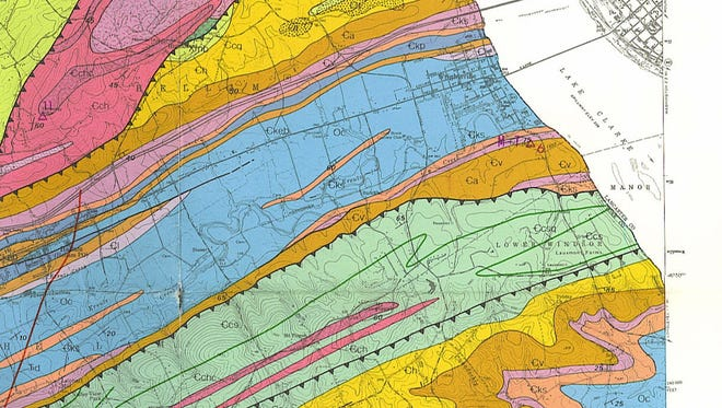 Wilshusen (1979) map of eastern York County.  Dark lines with saw teeth represent thrust faults.  Saw teeth on upper plate.  Colors represent various rock types.  Arrow at top points to Accomac volcanic rocks.