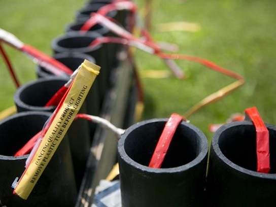 The fuses of 3-inch shells stick out of tubes.