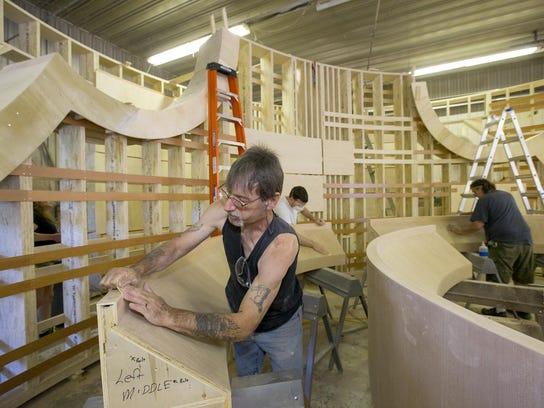 Jeffrey Shaver of Dryden uses 150 grit sandpaper to